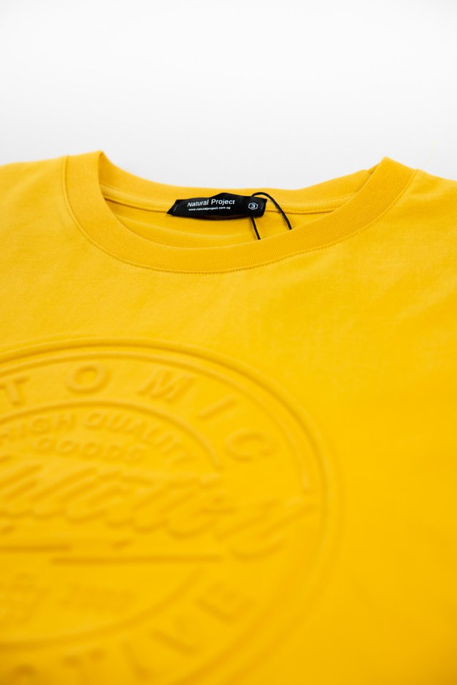 Atomic Embossed Crew Neck Tee in Mustard
